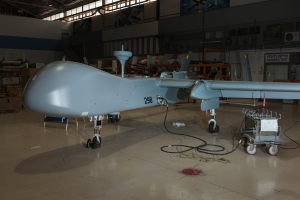 Near Airport City, Israel - The IAI Heron TP, inside a hangar at the company's drone factory, near Ben Gurion Airport, Israel. The Heron TP is A MALE UAV used for long-range surveillance and strike missions. Armed UAV's are sometimes classified as unmanned combat aerial vehicles (UCAVs). The Heron TP is the largest drone produced in Israel, with a wingspan longer that a 747 airliner, it can stay in the air for more than 30 hours. 